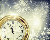 Vintageclock with fireworks and holiday lights. New Year's at midnight - Old clock with fireworks and holiday lights Royalty Free Stock Image