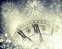 Vintageclock with fireworks and holiday lights Stock Images