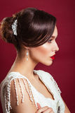 Vintager bride. portrait of the beautiful young girl in an image of the bride with ornament in hair.Red lips Stock Images