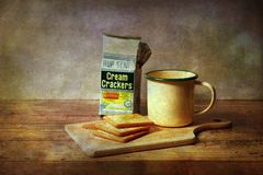 Vintages picture of breakfast and cream crackers on old style background Stock Photography