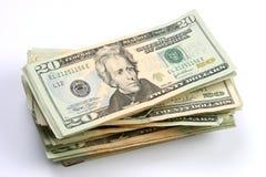Vinte dólares de contas empilharam Fotografia de Stock
