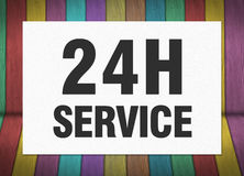 Vinte quatro horas de sinal do serviço no Livro Branco fotos de stock royalty free