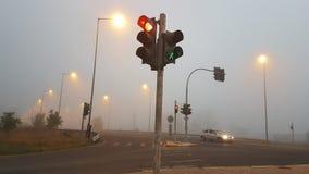 vinter för väg för trafikljusdimmamorgon royaltyfria foton