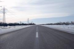 Vinterasfalthuvudväg Royaltyfri Fotografi