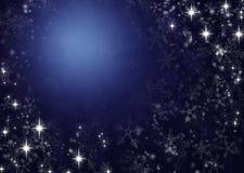 Vinterbakgrund från snöflingor arkivfoton