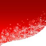 Vinterbakgrund i rött med vita snöflingor Arkivbild