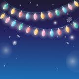 Vinterbakgrund med girlandlampor Arkivfoton