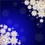 Vinterbakgrund med snöflingor Arkivfoto