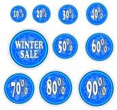 Vinterförsäljningsklistermärkear med snöflingan. Arkivbilder