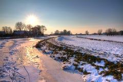 Vinterflodsolnedgång HDR royaltyfria foton