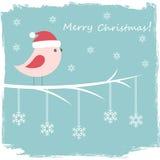 Vinterkort med den gulliga fågeln Arkivfoto