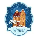 Vinterkortdesign med huset och träd Arkivbild