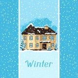 Vinterkortdesign med huset och träd Arkivfoto