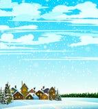Vinterlandsckape med skogen och hus Arkivbild