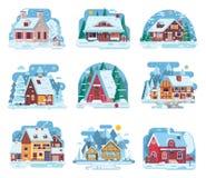 Vinterlandshus och kabinuppsättning Arkivbild