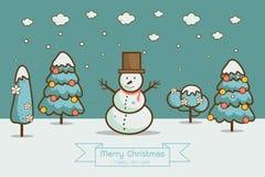 Vinterlandskap med julgranar, snögubbear, Arkivbilder