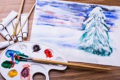 Vinterlandskap som målas med en borste Arkivbild