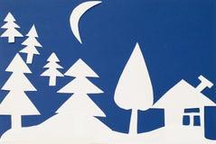 Vinterlandskap som snidas ut ur papper Arkivfoton