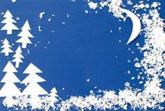 Vinterlandskap som snidas ut ur papper Arkivbilder