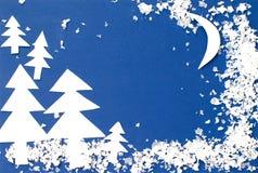 Vinterlandskap som snidas ut ur papper Royaltyfri Foto