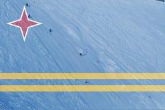 Vintern skidar temat med att blanda den Aruba flaggan Arkivfoton