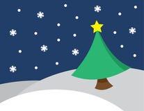 Vinterplats som snöar trädstjärnan Arkivfoto