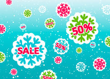 VinterSale affisch med färgrika snöflingor arkivfoton