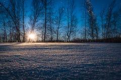 Vintersolnedgång och skuggor Royaltyfri Foto