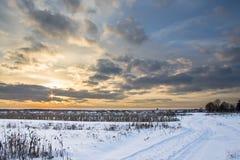 Vintersolnedgången landskap Arkivfoto