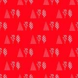 Vinterträd på en röd bakgrund Arkivfoton