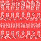 Vintertumvanten och sömlös modell för sockor Hand dragen stil Dekorativa beståndsdelar för jul Röda färger Fotografering för Bildbyråer