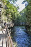 Vintgar gorge and woman on wooden path. Bled, Slovenia. Stock Photos