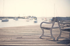 Vintge port benches. Vintage benches in a port boardwalk Royalty Free Stock Image