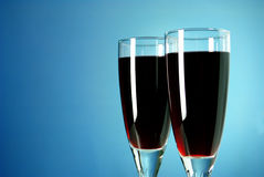 Vinyh two glasses on a blue background Stock Photos