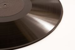 Vinyl. Part of a record, isolated on white stock image