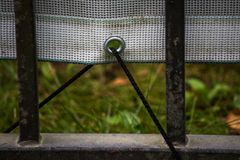 Vinyl banner attached to the fence rope through the metal ring. Is close stock image