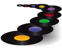 Vinyl with colored stickers. Black vinyl with colored stickers on a white background Stock Photography