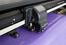 Vinyl cutter. Cutting a purple vinyl Royalty Free Stock Image