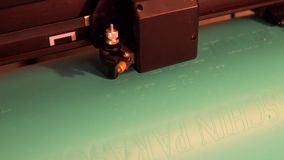 Vinyl cutting letters with the cutter machine stock video