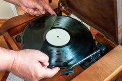 Vinyl disc in hand Stock Images