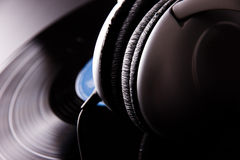 Vinyl disc with headphones Royalty Free Stock Photography