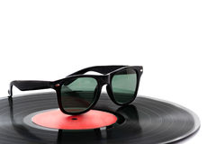Vinyl disc LP with sunglasses Royalty Free Stock Photography