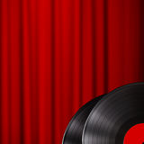 Vinyl disc with red curtain background Royalty Free Stock Photos