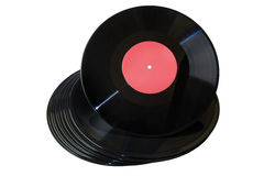 Vinyl disc with red label on vinyl stack Royalty Free Stock Images
