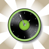 Vinyl disk style clock with green border. And striped background Stock Images