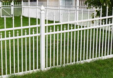 White Vinyl Fence. By green lawn Royalty Free Stock Photos
