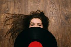 Vinyl. Girl and vinyl records. Retro royalty free stock image