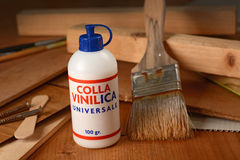 Vinyl glue on the wooden table Royalty Free Stock Image
