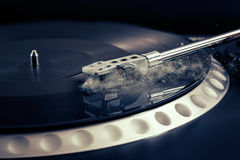 Vinyl laying on a record player - scratching the surface Royalty Free Stock Image