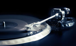 Vinyl laying on a record player - scratching the surface Royalty Free Stock Images
